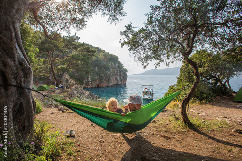 boy is swinging in a hammock