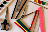 School supplies on the white background: watercolor, pencils and brushes. School and education. Colorful accessories. Preparation for school. Art composition. Drawing and painting. - 203842567