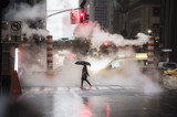 A woman with an umbrella and red high heels shoes is crossing the 42nd street in Manhattan. Taxi and steam coming out from from the manholes in the background. New York City, Usa. - 203847948