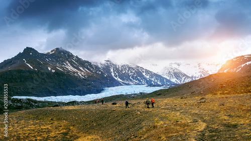 Tourist taking in Skaftafell glacier, Vatnajokull National Park in Iceland.