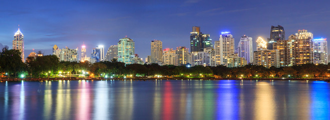 Panorama lake view in the city with reflections on the water / lake view park in twilight time © rukawajung
