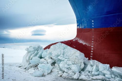 fototapeta na ścianę Nose icebreaker stuck in the ice of the Arctic landscape. Begins a snow Blizzard.
