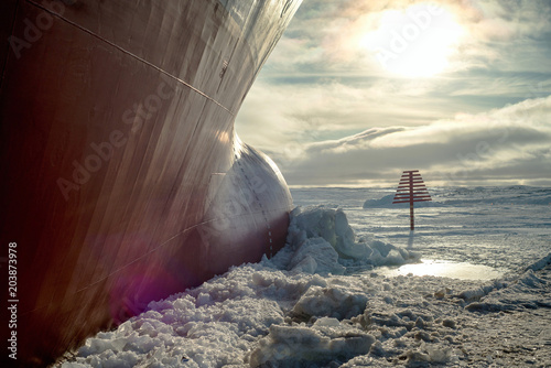 obraz lub plakat Nose icebreaker stuck in the ice of the Arctic landscape. Begins a snow Blizzard.
