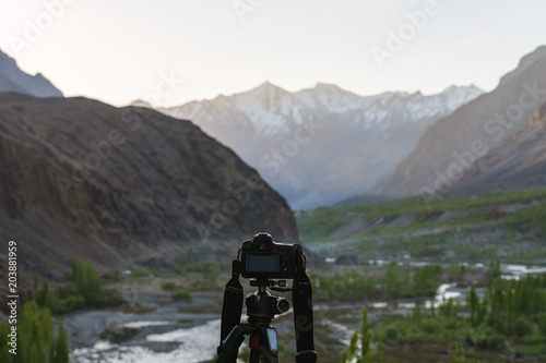 Taking landscape photography by dslr camera, at Hunza valley in Pakistan