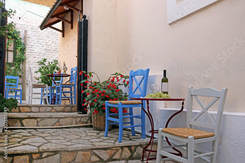 Wine and grapes on the table taverna Parga Greece