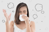 Asian woman in white dress catch her nose because of a bad smell against gray background. - 203886952