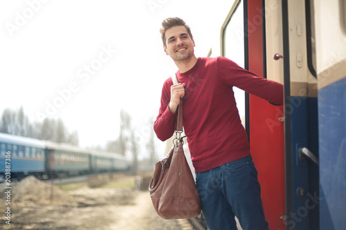 Guy leaving on a train for a new adventure