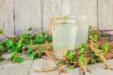 birch sap in a glass. Selective focus.