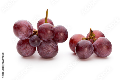 Foto Murales Ripe red grape isolated on white.