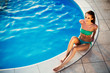 Exotic beautiful woman sunbathing and swimming
