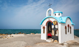 Colorful greek orthodox chapel by the sea near Chania in Crete, Greece - 203899503