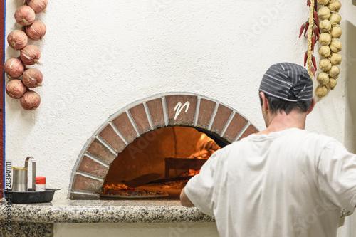 Plexiglas Pizzeria Pizza in a hot oven