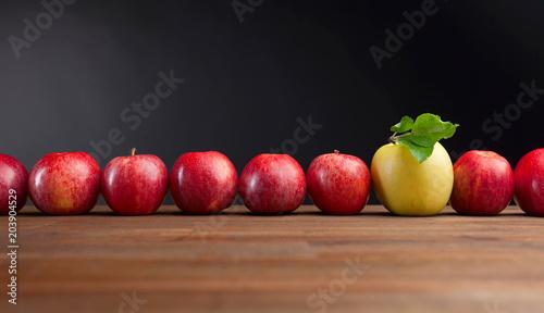 Foto Murales Ripe juicy apples on a wooden table .