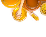honey dipper and honey in jar on white background - 203909399