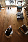 woman sitting on the wooden floor - 203912316