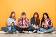 Group of young cheerful school friends using mobile phones - 203912566