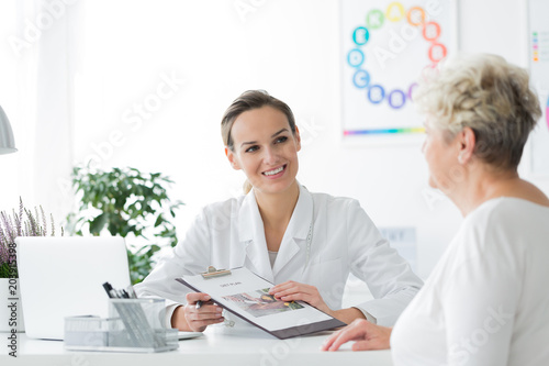 Smiling dietician with her patient