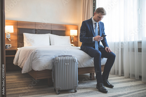 Wall mural Young businessman in the hotel