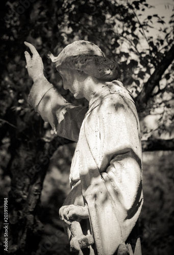 canvas print picture Angel stone figure on Melaten Cemetery in cologne on a summer day