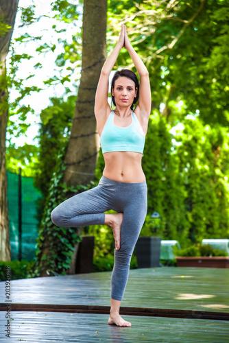 Poster Girl doing yoga outdoors