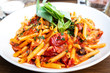 tasty pasta Italian tomato sauce pasta on the table - 203924769