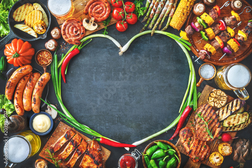 Grilled meat and vegetables on rustic stone plate - 203925507