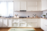 Modern kitchen interior design with white furniture and modern details - 203941138