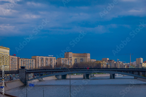 Outdoor panoramic view of Moscow and bridge over the Moskva River in conecting modern skyscrapers of Moscow-City. Landscape and cityscape of Moscow in cloudy sky