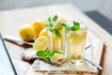 Refreshing summer drink with lemon, mint and ice copy space