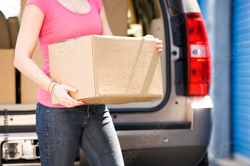 Storage: Anonymous Woman Holding Box