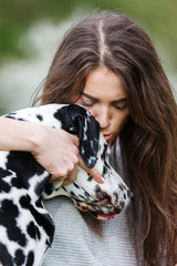 portrait of a beautiful woman with her Dalmatian dog
