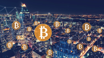 Bitcoin with the New York City skyline at night