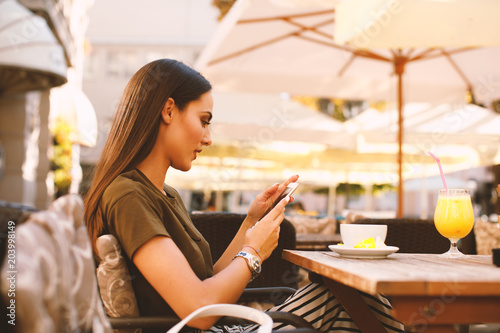 Young woman online on social networks via smartphone