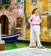 Young woman standing on street in venice, italy