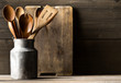 Wooden kitchen cooking tools with spoons and spatula with menu board in front of rustic wooden board background