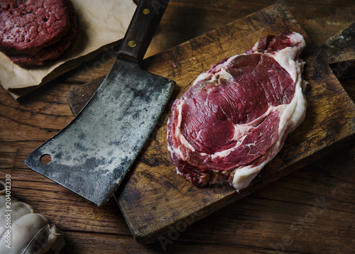 Tomahawk beef steak at a butcher shop - 204012330