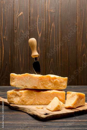 Fototapeta pieces of parmesan or parmigiano cheese and grapes