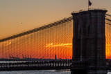 Brooklyn Bridge and Statute of Liberty at sunset