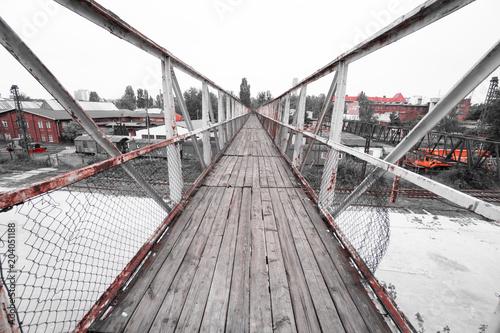Fotobehang Oude verlaten gebouwen Old wooden bridge above abandoned train station
