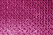 Diamond shaped metal floor pattern in pink tone.
