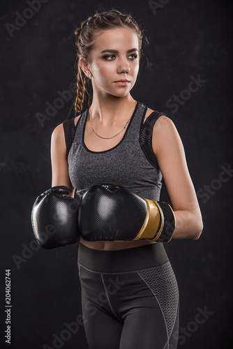 Sports girl in boxing gloves