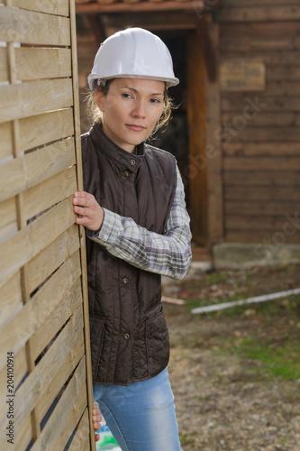 Fototapeta woman wearing hardhat spying