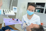 Dentist working on patient's teeth