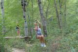 woman on the zipline - 204115940