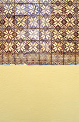 Surface of front wall, half of tiles and half painted, architectural textures and background