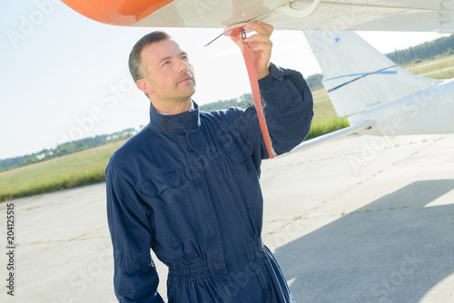 Mechanic unlocking compartment on aircraft