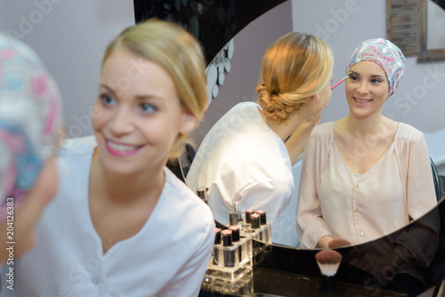 young beautiful woman in spa environment taken care of