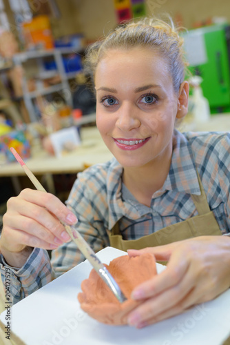 artist with a pot bowl