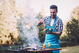 Handsome man preparing barbecue - 204129961