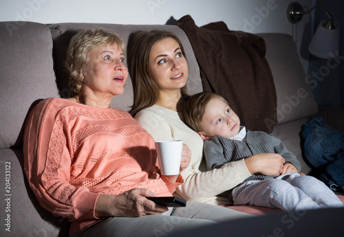 Family is watching emotional film in evening